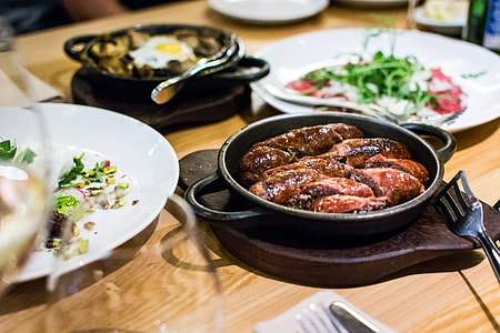 the correct way to cook sausages - sausages in a frying pan
