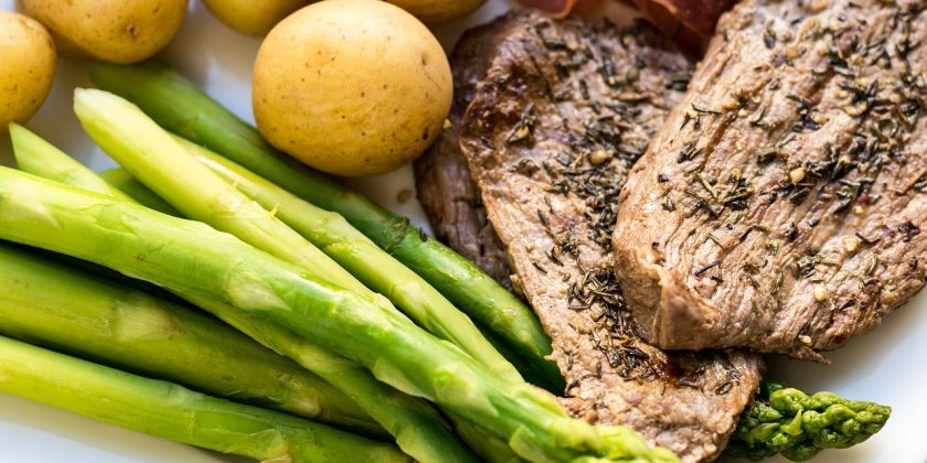 good reasons for eating beef - steak with asparagus and potatoes