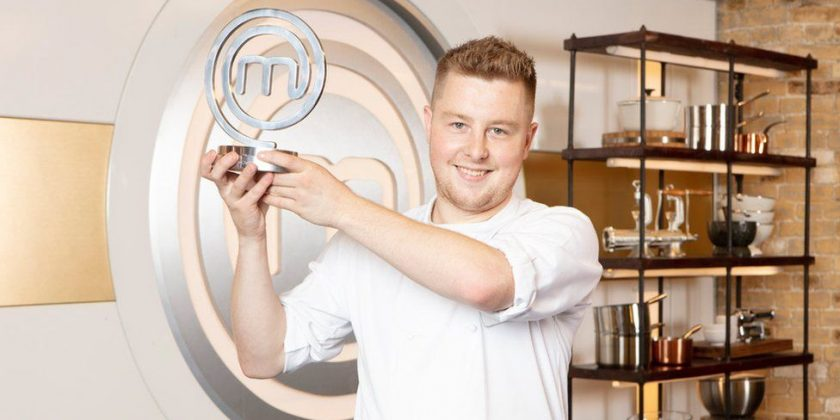 Alex Webb holding Masterchef trophy